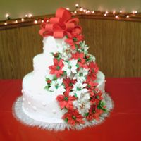 Poinsetta/christmas Wedding Cake This is a white/chocolate/white cake with BC frosting. The poinsettas and holly are gumpaste. I bought them at Sugarcraft after my woeful...