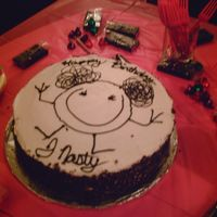 Character Cake This is a mocha cake, covered in BC with chocolate curls around the edge. The character is a stick figure my daughter first drew when she...