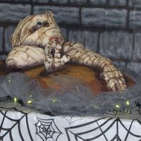 Mummy Cake This was made for a Halloween themed baby shower. The base is DH Halloween marble cake w/BC sanded w/natural sugar. The life-sized mummy is...