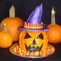 Witch Pumpkin   Carved cake and covered in fondant. Hat make out of fondant and decorated with candy corn.