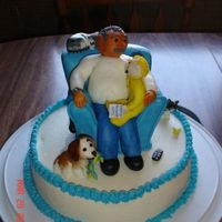 "Grandpa & Grandson   Sculpted pound cake recliner covered in mmf. Figures mmf and 9"" cake in buttercream."