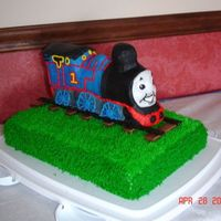 Thomas The Train   Sheet cake covered in bc with 3-D train decorated like Thomas. Mmf for the face.
