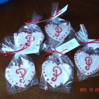 Monogrammed Wedding Cookies  Made 100 sugar cookies shaped like hearts added MMF then piped the dots and initial using Alices icing recipe and dipped cookies in red...