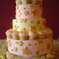 Princess Cupcake Tower This is a revolving tower of cupcakes that I did for a princess themed baby shower. It featured the shower's signature colors, pink...