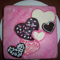 Our First Valentine's Day Cake  At first it was a mess, we tried to pour chocolate over the top, but the chocolate got hard before we could even pour it. But at the end it...