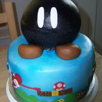 Bomb Bomb Cake  this was for my son's 8th birthday. i wasn't too thrilled about doing a super mario brothers cake for the third year in a row and...