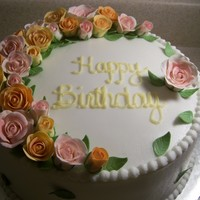 60Th Birthday This was for a friend's mother who turned 60. Vanilla cake. White buttercream. Gumpaste/fondant roses and leaves.