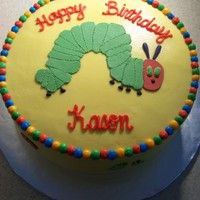 The Very Hungry Caterpillar   chocolate cake with cakepro's buttercream. fruit and caterpillar are 50/50 fondant/gumpaste mix.