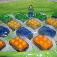 Joey's Lego Birthday Made using mini cake pans. Iced with glacee icing. Lego studs were halved mini marshmallows. Figure is of my son made with a 50/50 fondant/...