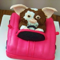 Gizmo the car is cake covered in fondant. Gizmo is made out of RKT and fondant.