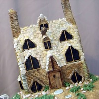 Shell Cottage The beach is made from oval cake pans and are covered in buttercream and brown sugar. The water is royal icing. The cottage is covered in...