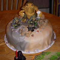 Rancor Star Wars Cake Another Star Wars action figure set used to decorate a cake. Everything else besides the figures are edible.