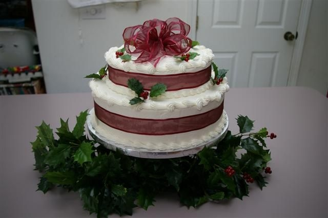 Imgp4356_Small.jpg choc. 2 tier w/ bc and artificial holly. The ribbon and holly match the bride's decorations