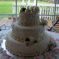 Fondant Wedding Cake With Pink Roses  This is this cake that I made I made for my wedding. Its fondant with gumpaste roses. I got my inspiration from bjfranco. Mine does'nt...