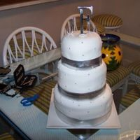 "First Paid Wedding Cake This is a 6. 8, and 10"" carrot cake with cream cheese frosting. I had so many problems with the fondant and I don't know why. It..."