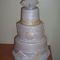 Baptism Cake Here is a cake for my God Daughter's baptism. It is covered in fondant and has gold accent paint and air brushed luster dust on the...