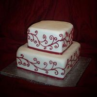 "Red Scroll This is a small wedding cake - 8"" and 6"" square pan. It was inspired by a picture from the bride (which I do not know where it..."