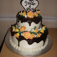 Julie's Shower Cake White Almond Sour Cream with raspberry buttercream and ganache. The roses are her fave flower (gumpaste) and the heart is chocolate. This...