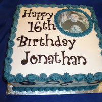 "Jonathan's 16Th This was a 10"" square chocolate with buttercream and fondant accents.. picture is edible image. Also imprinted a slant stripe bottom..."
