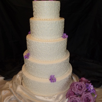 "Samantha  layers 14"" 12"" 10"" 8"" 6"" buttercream frosted White, chocolate, lemon, spice, lemon swirls piping on all layers....."