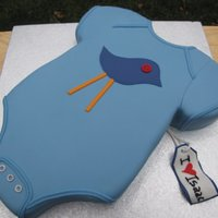 Birdie Onesie Onesie cake for my nephew Isaac's baby shower. Carved out of two 9x13's side by side (so 13x18 I guess!). Covered in MMF with...