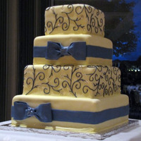 "Shelyse 6"", 8"", 10"", 12"" Squares covered in MMF with fondant/gumpaste ribbon and bows. Piping in royal icing with silver..."