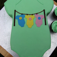 Clothesline Onesie I did a wedding cake for this couple last year, so fun to do a baby shower cake for them! The mother of the mother to be really liked my...
