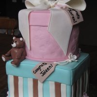 One Boy, One Girl! Baby shower for friends who are due on the same day. One is having a boy the other is having a girl! All fondant with gumpaste bow and bear...