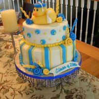 Rubber Ducky Graduation This was made for a high school graduation. The girl collected rubber ducks. The duck, spirals, and roses are made of fondant. Iced in...