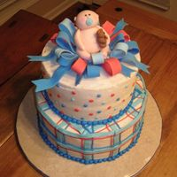 Baby Boy Cake French Vanilla cake, buttercream icing. Baby and ribbons in fondant. This was inspired by the amazing cakes by the artist at cakestrings....