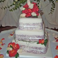 Contemporary Ivory & Lilac Wedding Cake  This wedding cake was covered in ivory fondant, and decorated in the lilac ribbon the couple used on their wedding invitations. I also...