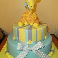 Baby Girrafe  I made this cake as a gift for a beautiful baby boy who was recently born. The giraffe was made of fondant, and the cake was also covered...