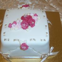 Mother's Day Cake - Piped Roses  This cake is delightful as it has ivory piped leaves among different shades of pink piped roses, satin ribbon and crimped edges. This cake...