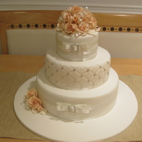 Wedding Cake With Peach Roses  This cake was done for my wonderful brother in law & his beautiful wife. This is the 2nd wedding cake I have done and the first time I...