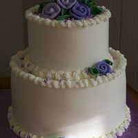 "Wedded Bliss 6"" & 9"" tiered cake. Satin Ice roses & pearls. Iced in WBH buttercream."