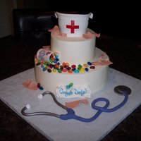 "Nursing School Grad Fondant hat, stethascope, pill bottle, band-aids & jelly belly ""pills"""