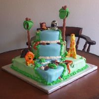 "Jungle Cake This was my first time using fondant. I used MMF to mold the animals, palm trees, rocks, and for the waterfall. Bottom tier was 12""..."