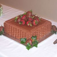 "Chocolate Basketweave Groom's Cake This was a 12"" square grooms cake. Chocolate cake, chocolate buttercream, chocolate covered strawberries and english ivy."