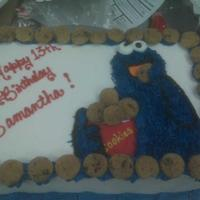 Cookie Monster Birthday Cake This cake was made for a young teen who simply loves the blue furry cookie gobbler from Sesame Street.
