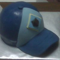 Cubs Scout Hat I used the sports ball pan for the main part of the hat and then cut the brim from fondant. The logo on the front was created by pressing...