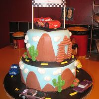 Cars Cake Two tier cars cake with lightning mcqueen and friends. Fondant with buttercream accents.