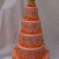 Dotty Pink My first ever wedding cake! It's made with dummies as I did it for class, but everything else is real. All layers covered in pink...