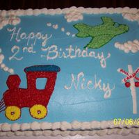 Happy Birthday Nicky Half sheet cake for a friends sons 2nd birthday. All freehand buttercream designs.