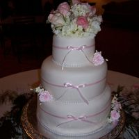 Pink And White Wedding Cake 3 tiered wedding cake, 1st and 3rd tiers are white cake with raspberrry and buttercream filling, and 2nd tier is chocolate with raspberry...