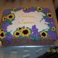 Basket Of Grapes And Sunflowers  Made this cake for the one year anniversary of a local restaurant. She requested a cake with grapes and sunflowers, so I thought this was a...