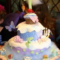 Fancy Nancy  This cake was for my daughter's seventh birthday (Fancy Nancy theme). The bottom layer was strawberry cake, middle layer was sour...
