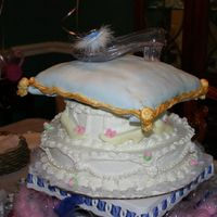 Cinderella Cake   wedding cake with buttercream frosting and fondant pearls. Top layer is wedding cake with oreo filling and fondant.
