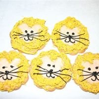 Lion Cookies   These were made with a flower cookie cutter. Royal frosting. The mane was made with the grass/fur tip.