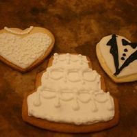 Wedding Cookies  This idea came stright from this website. The only difference was that I rolled out MMF and cut the same design with the same cookie cutter...