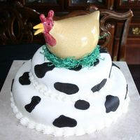 Chick Fil A   This is the cake for a Chick Fil A party. Butter cake with oreo filling. Fondant.